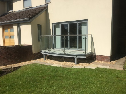 ground floor balcony made out of glass and stainless steel